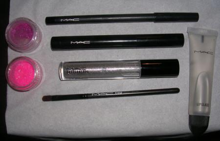 All MAC stuff: 316 lip brush, greasepaint stick, Feline kohl power liner, She-Zam dazzleglass, clear lipglass, Reflects Very Pink and Neon 60s glitters.