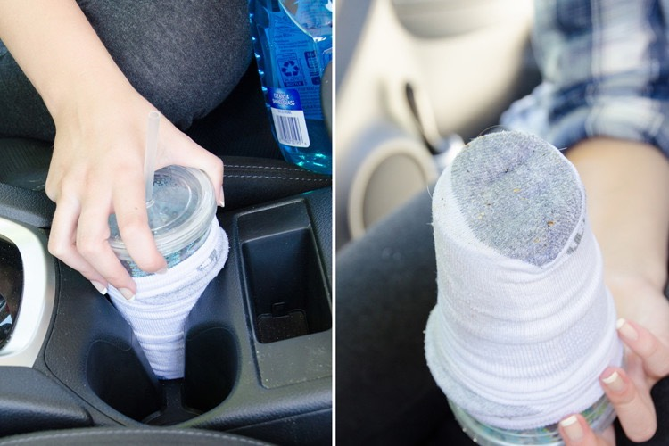 11. Use an old sock, Windex, and a travel cup to clean cup holders. Put an old sock over the bottom of a travel cup, spray with Windex, and twist to remove dirt and grime in cup holders.