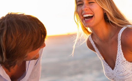 Smile and laugh. Our brains are interconnected with our emotions and facial expressions. When people are stressed, they often hold a lot of the stress in their face. So laughs or smiles can help relieve some of that tension and improve the situation.