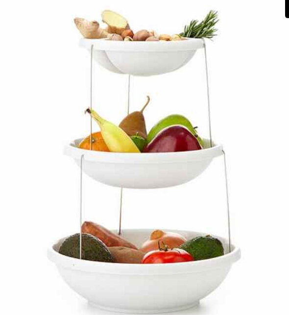 Three-tiered bowl for anyone who really loves fruits and vegetables. Plus, they nest together. ($29.99)  http://www.uncommongoods.com/product/twist-fold-3-tiered-bowl