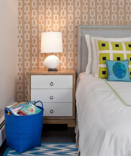 Pattern Play A graphic paper for the wall doesn't necessarily demand color. Be less predictable with your decorating style by choosing to add vibrancy with your accents instead.