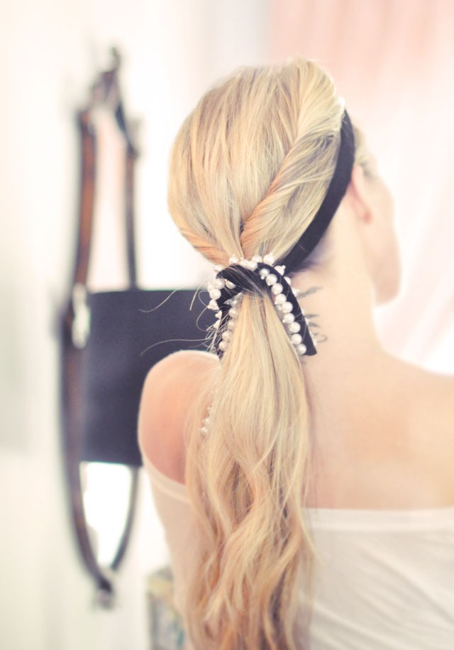 5. Finish it off with a pretty scarf or ribbon by placing the center of your ribbon at your middle part in front of your twists above your forehead, then swooping it down under your ponytail, crossing it, then bringing it back up to finish in a knot or bow.