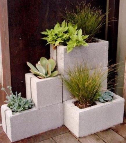 Concrete Block Planters  Normally I hate concrete blocks, but I love the modern and clean look of this geometric planter. Easy and quick to do, and super durable.