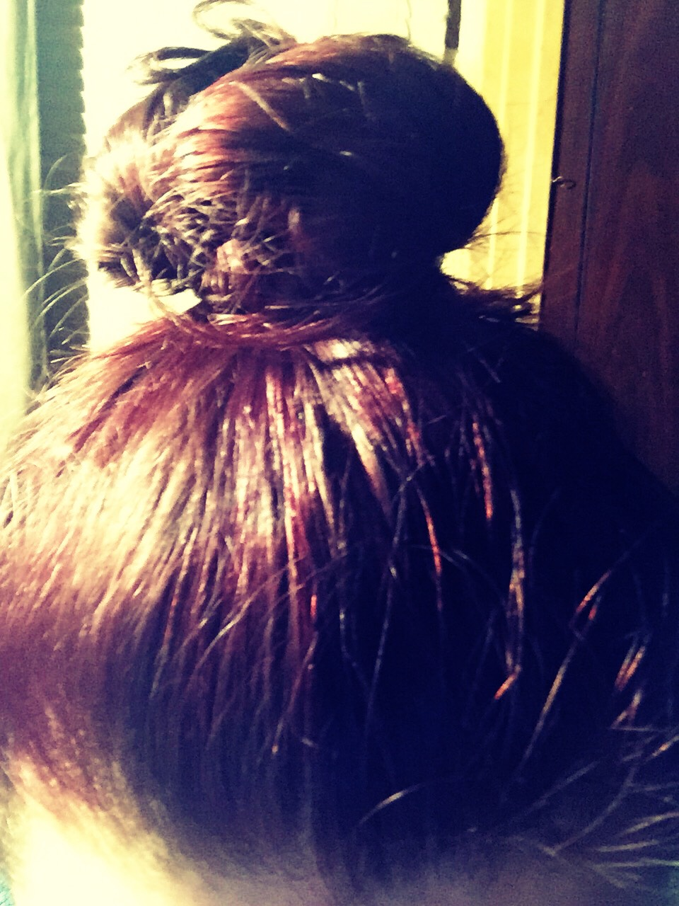 STEP TWO: let hair dry until damp then put into a tight bun!