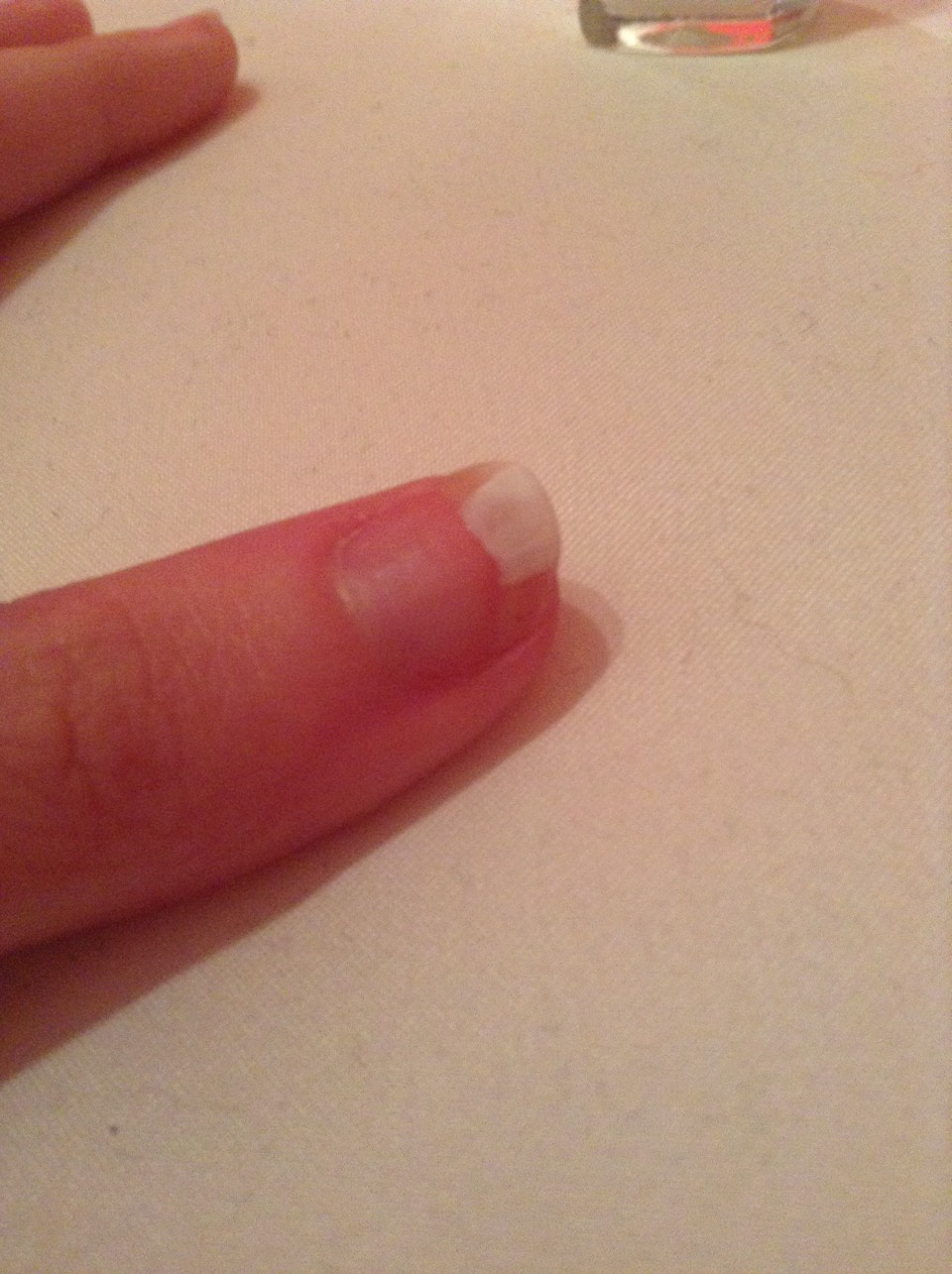 At the tip of ur nail start painting a white curved line with ur white nail poilish