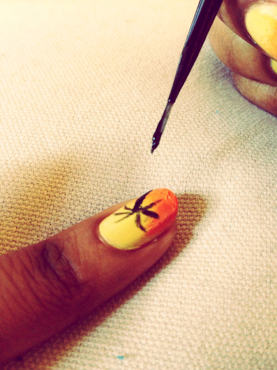 Using nail art brush (or toothpick) draw on a palm tree using black nail polish