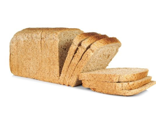 Start by cutting the crust off of bread. And cutting them in half into triangles.