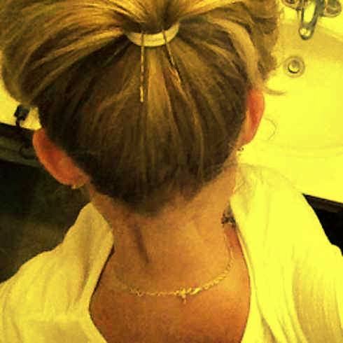 4. Make your ponytail POP by propping it up with two bobby pins.