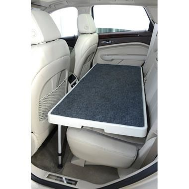 4. Reduce dog anxiety while riding in a car by installing a stable car seat.