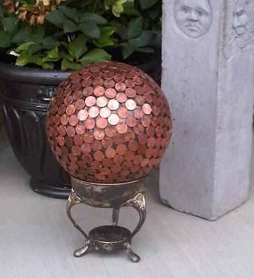 FULL TUTORIAL HERE:  http://www.houseofhawthornes.com/2010/06/bowling-ball-yard-art.html