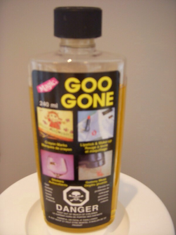 Get either goo-be-gone or greased lightening and pour on the stain. Use a cloth to scrub the stain until it is gone. You can repeat this 2 to 3 times until the stain is gone.