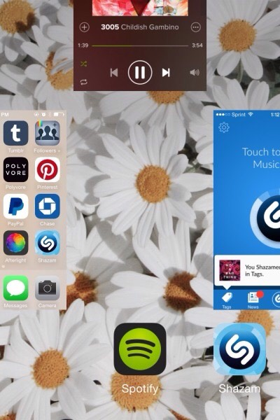 Swipe the screen upwards where the spotify picture is, this will close the spotify app