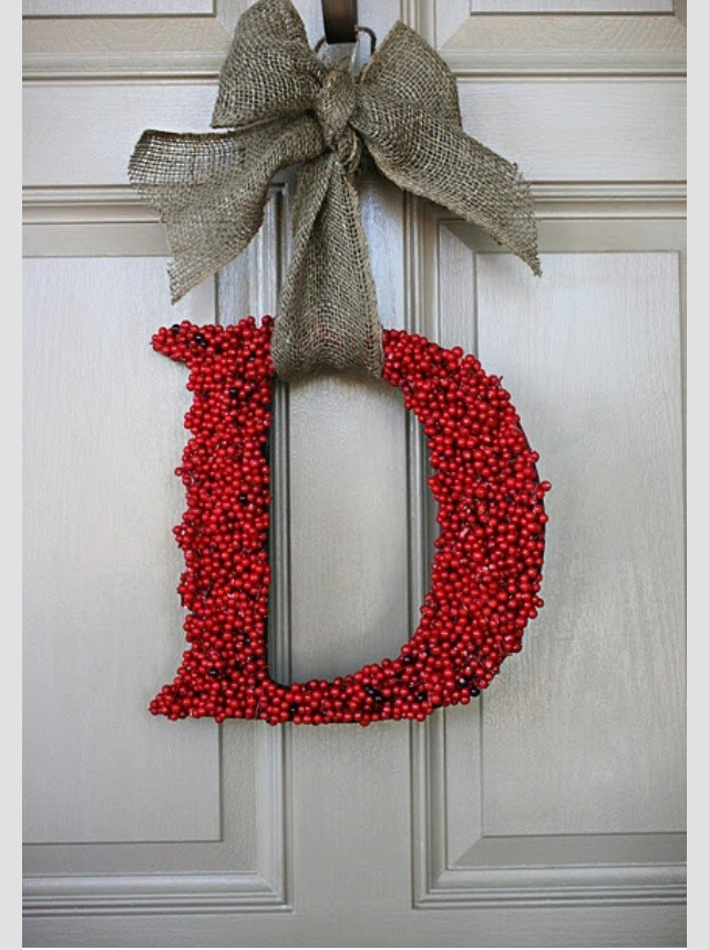 Glue holly berries and add a bow