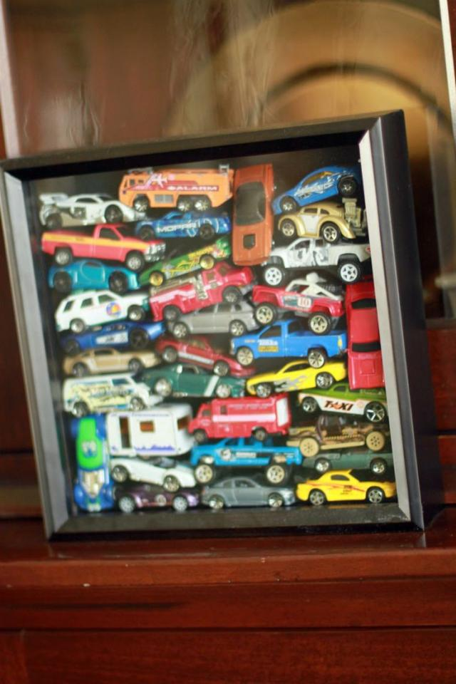 Fill a shadow box with some of your childs favorite toys (once they out grow them) and hang as decorations in thier room.