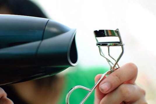 Hold a blow dryer up next to your lash curler for about 3-5 seconds. The heat works the same way as it does with your curling iron, giving you those flirty lashes that will last all day.