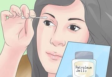 Use petroleum jelly. Gently apply a thin coat of petroleum jelly over your upper lash line using clean fingers or a cotton swab. You can apply it before bed, if desired, and sleep with it on, or you can apply the petroleum jelly during the day.