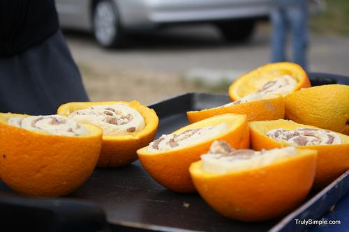 Put the oranges onto a baking sheet or something you can throw on top a fire