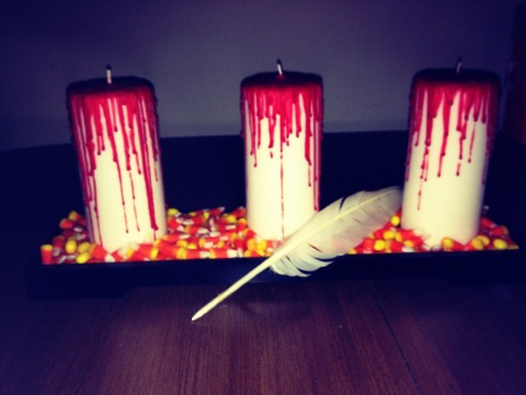 Make 3-4 bloody candles. Set them up on our mirrored tray from earlier and add candy corn for a spooky centerpiece this halloween!