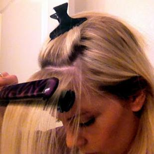 6. Use a flat iron to tame your cowlick and get perfect side-swept bangs.