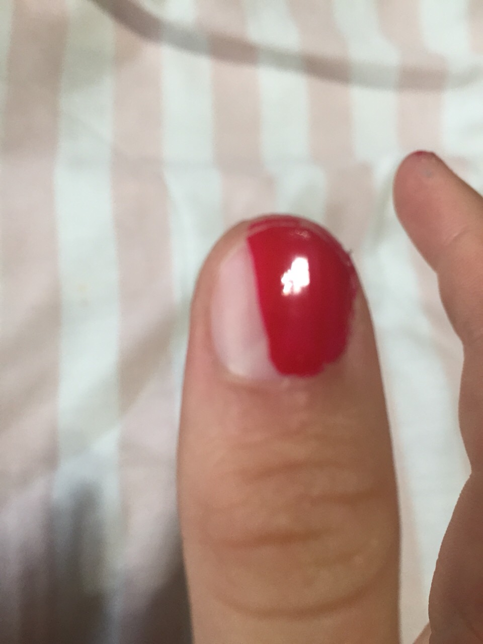 Paint 1/2 your thumb red