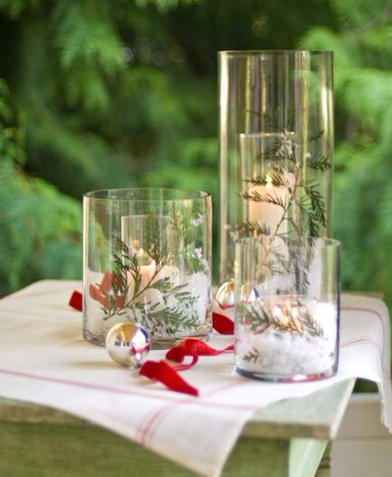 Snowy scenes  Create a white Christmas using inexpensive glass cylinders from a crafts store. Place one cylinder inside a larger one, then sprinkle a dusting of fake snow between the two and nestle a sprig of greenery on top of the snow. Add a pillar candle or battery-operated candle in the center!