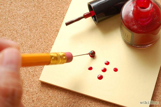 Stick a sewing needle into a pencil for a cheap nail dotter.