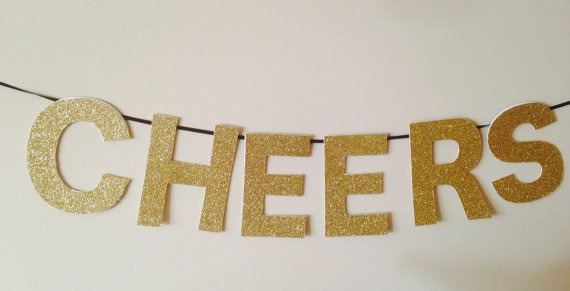 5. Gold Glitter Cheers Banner, perfect for New Years but can also be saved for other parties such as bachelorettes, Christmas, etc. From Seventh and J, $12.50.