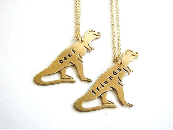 A set of t-rex pendants.  Maybe your friendship will last even longer than the Jurassic period.  https://www.etsy.com/listing/104457885/best-friends-t-rex-necklace-set