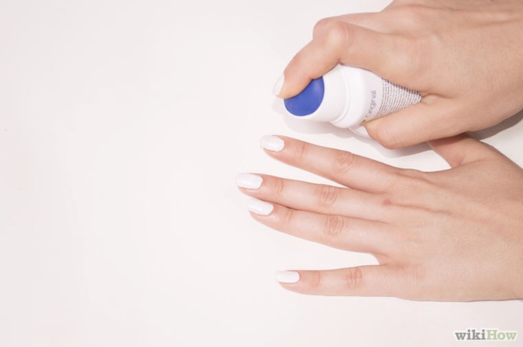 2. Spray some deodorant from as close to your nails as you can. Make sure you don't injure yourself if the deodorant has a quick evaporating propellant that will cause freeze burns— it will work better this way.