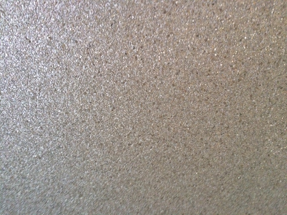 Pebble textured gold and silver wallpaper