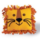 For a twist on this gift: Try a different shape, such as this lion pillow. We knotted together squares of orange and yellow fleece and brought our king of the jungle to life with cord whiskers, and felt eyes and nose attached with tacky glue. For square pillows, cut off and discard the corner fringe