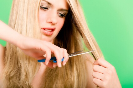 Before cutting off those split ends, try applying some vaseline to shut them