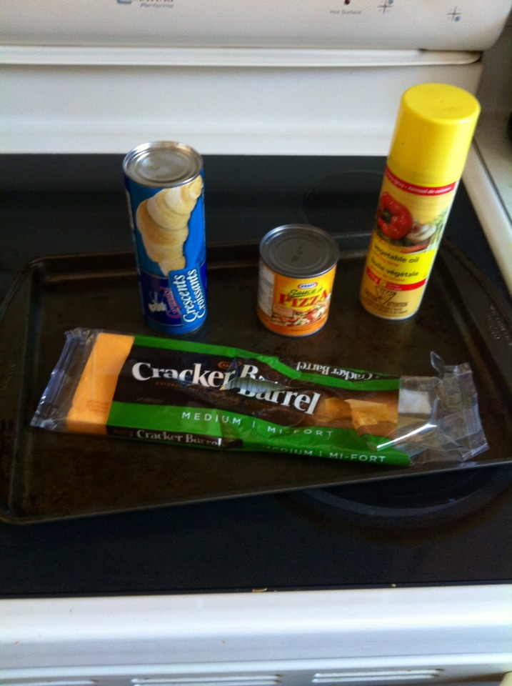 1. Gather all the ingredients: vegetable oil, croissants, pizza sauce and cheese.