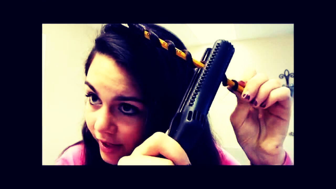 Then you clamp the straightners onto the hair for about 20 seconds and do this to your whole head