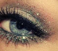 Apply glitter to the center of your eyelid using a wet brush to keep it from falling all over your face