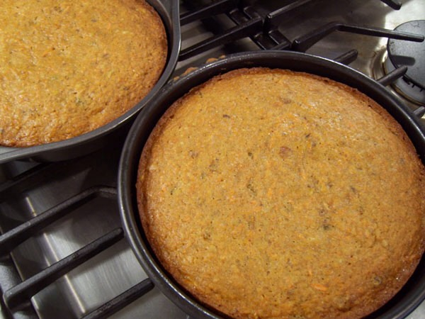 Bake the cake until the top springs back when gently pressed and a toothpick inserted into the centers comes out clean, about 1 hour to 1 hour and 10 minutes. Set the cake on the baking sheet on a wire rack to cool for 10 minutes. (The cake will pull away from the sides of the pan.)