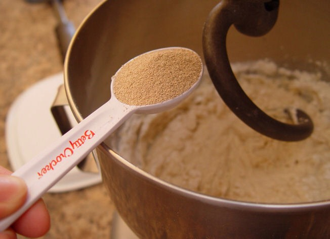 3. Put your milk/butter and hot water in the bottom of your Kitchen Aid Mixer. Add the sugar and salt. Then add 2 C of the flour…let it mix for 1 minute.  4. Add yeast. Turn the mixer on and add the rest of the flour 1 C at a time.