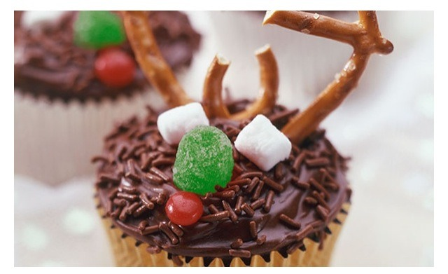 This one is super easy, just use pretzels and some Christmas candies to create your reindeer cupcake decoration!