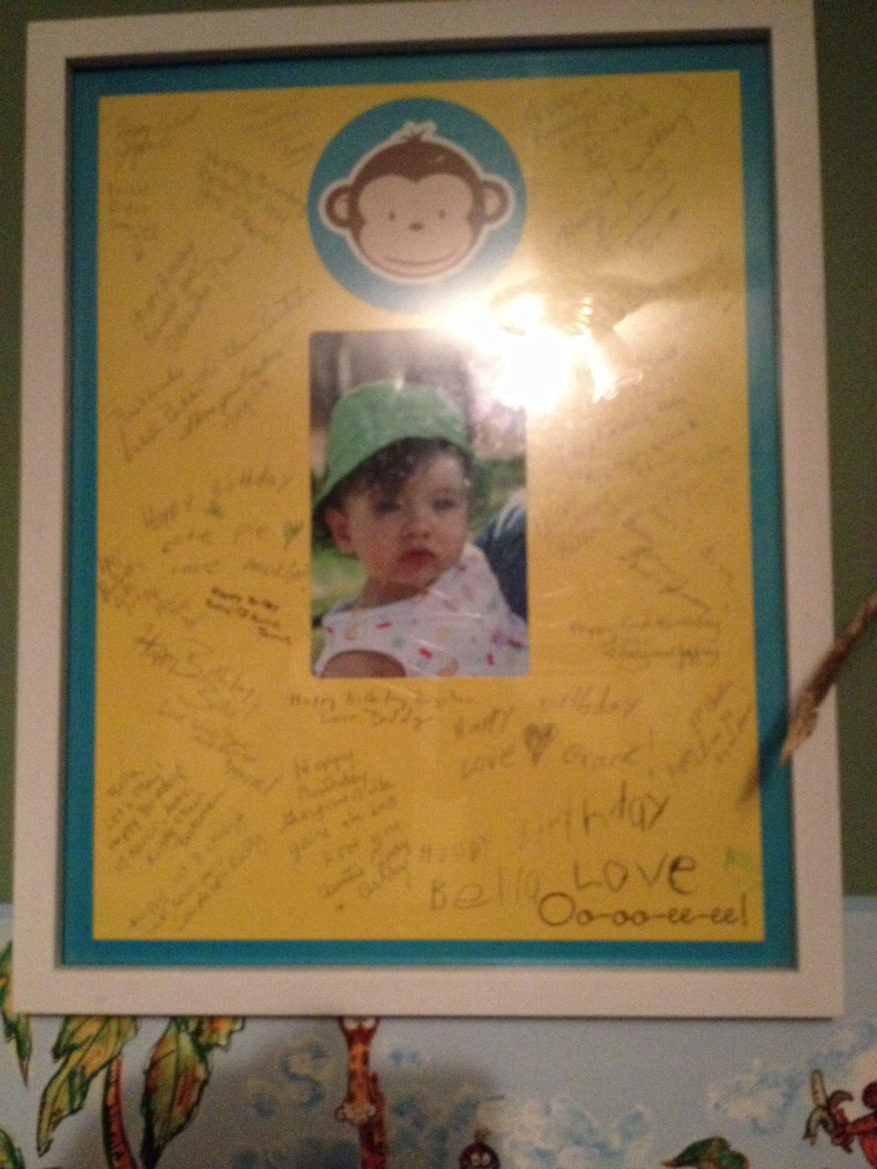 Not the greatest pic looks better in person take a piece of decorative paper draw an outline where pic will go and have everyone who comes to their party sign around photo after the party pick your fav pic from party place in center and frame. Your child will always know who was at their first bday