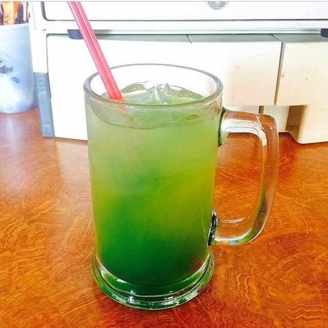 GREEN DREAM 1 oz. (30ml) Malibu Coconut Rum 1 oz. (30ml) Midori 1/2 oz. (15ml) Blue Curacao  Top with Pineapple Juice