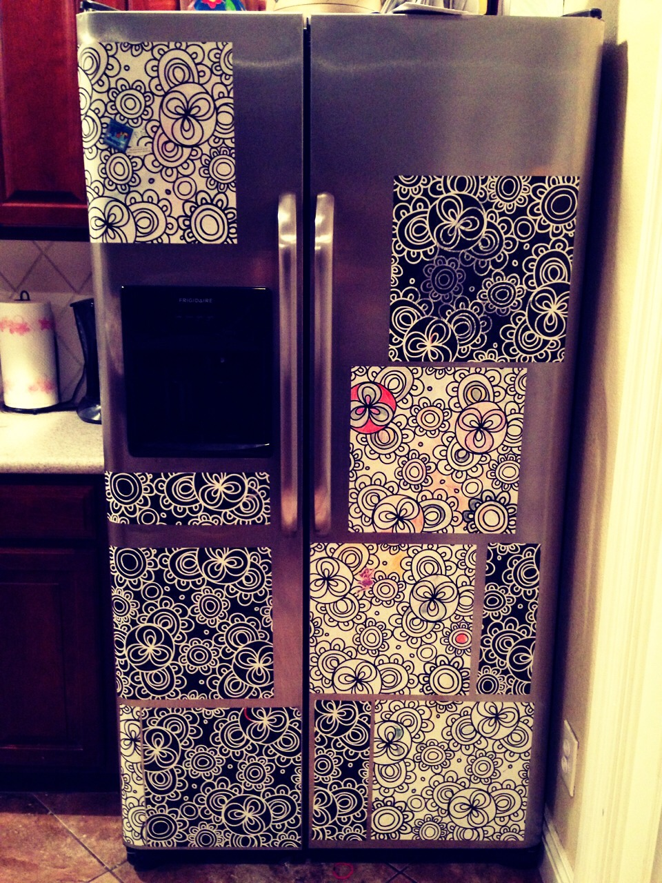 Plain refrigerator can become decor for your kitchen and also entertainment for little ones.  Wall Pops Wall Art can be a good way to hide the old boring fridge and the sticky fingers of little ones. Use washable markers to color over and over again by washing the marker away with a wet paper towel.