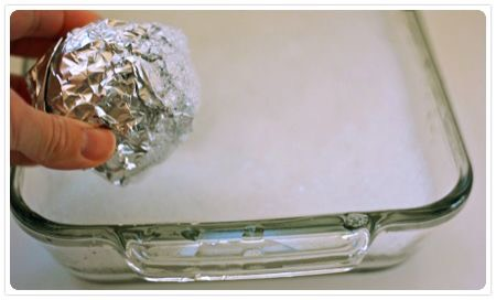 A wad of aluminum foil used as a scrubber will remove all those burn stains in a flash!