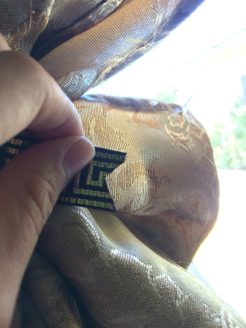 Hem Your Own Curtains for Cheap! Step 1:Long curtains fold em in half,iron out until straight then cut.With Magic tape or the hemming tape,fold over an inch or two over the tape in a straight line,iron until it sticks.then hem.Boom make a dove tail by folding ribbon end in half and snipping sideways