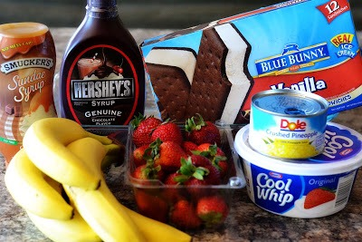 INGREDIENTS 19 Vanilla Ice cream sandwiches 1 (8 ounce) container Cool Whip 1/4 cup Chocolate syrup 1 pint fresh Strawberries, sliced 1-2 bananas, sliced 1 small can crushed Pineapple, drained  TOPPINGS Cool whip, or whip cream chocolate syrup caramel sauce cherries