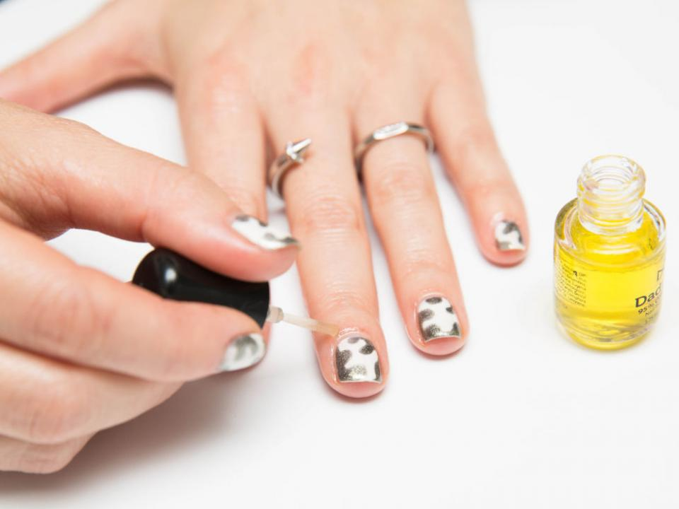 12. Apply nail oil daily to prevent your nails from drying out and splitting. The less moisture your nails and cuticles have, the more likely they are to break and tear.