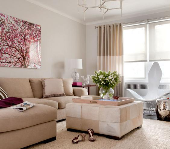 Touch of Trend Update your living room as you would your wardrobe—with a few new accessories each season. This neutral room is an easy canvas for a few pops of color and pattern—an aubergine throw, a zebra pillow, and a metallic side table.