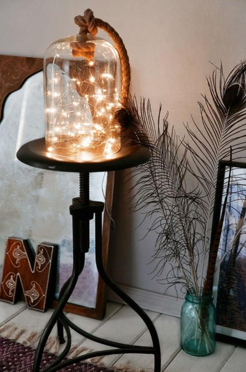 9. Put a battery-powered strand in a bell jar for an artsy DIY light.