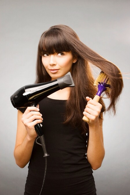 Drying your hair with a hair drier