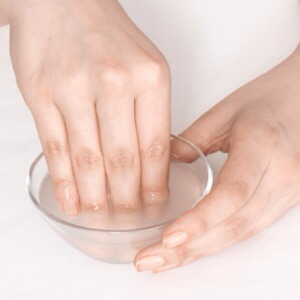 Dip your fingernails into warm water with a tea spoon of lemon. This will deep cleanse your nails and make it appear more white. The warm water will soften your cuticles.