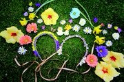 Supplies A variety of multicolored fake flowers  Cloth covered wire  Ribbon  Glue gun  Scissors  Bonus: Feathers, chains, charms  Tip: When picking out flowers, coordinate colors with your festival attire. Or keep it simple with spring whites and yellows to pair with all possible outfits.
